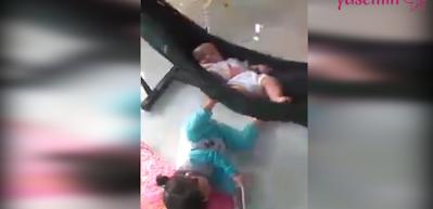 Kardeşini kendi yöntemiyle uyutan sevimli kız