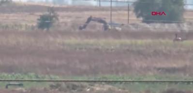Ortak devriyedeki helikopterleri gören teröristler, kazıyı bıraktı!