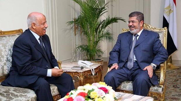 Eski Adalet Bakanı Ahmed Süleyman ile devrik Cumhurbaşkanı Muhammed Mursi...
