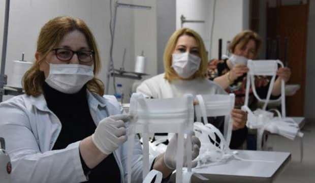 Meslek kursu muallimleri, sıhhat çalışanları için maske üretiyor 1