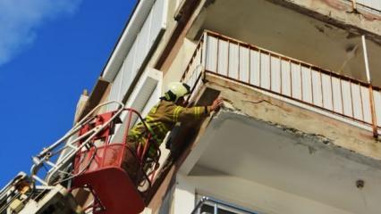 Depremden zarar gören binaya itfaiye müdahalesi