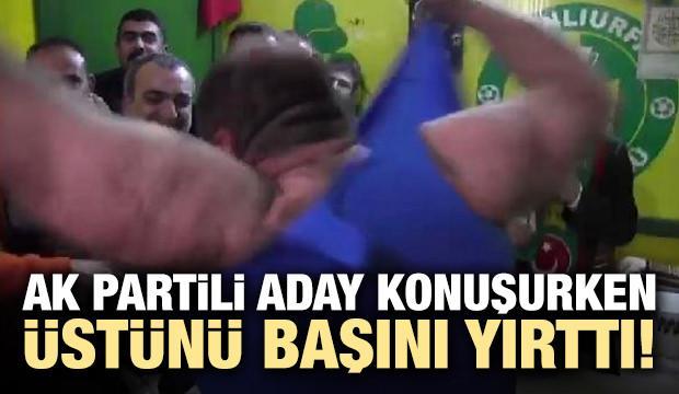 AK Partili aday konuşurken üstünü başını yırttı!