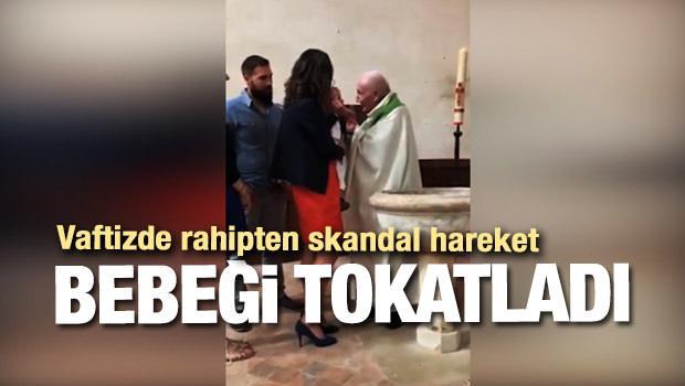 Rahip vaftizde susmayan bebeği böyle tokatladı