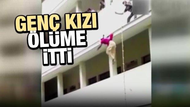 Genç kızı balkondan ölüme itti